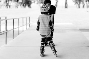 parent teaching a child to skate